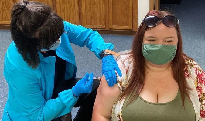 Lacey Shumard receiving her flu shot at the Monroe County Health Department