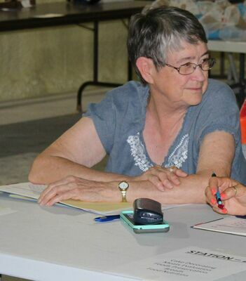 Ann Wideman was recognized for volunteering for 50 years in the Ralls County 4-H program.  Here Ann works at exhibit check-in at the Ralls County Junior Fair.