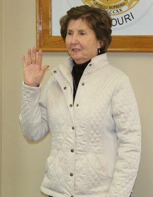Paula Evans, re-elected Public Administrator, is sworn in.