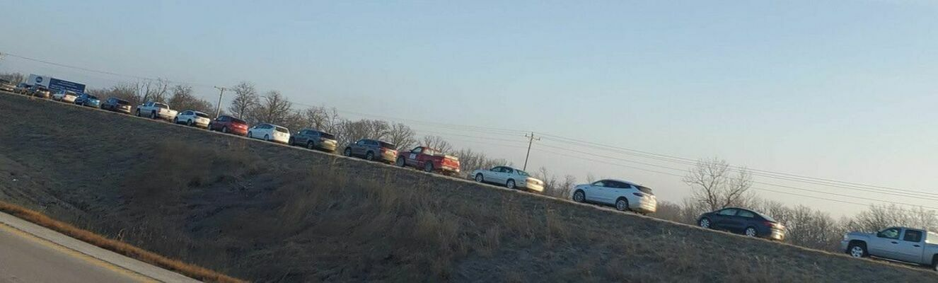 A line of cars quickly backed up on the northbound lanes of Highway 61 as people waited to get a vaccination shot at Ralls County Health Dept's Clinic last Tuesday.