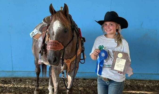 Kaelynn Bartels 1st place Pole Bending plaque with her horse Hannah