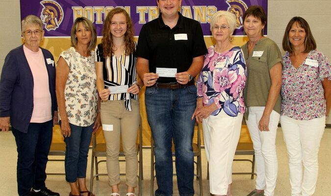 The Alumni group paused here to award to checks for scholarship to Ms. Hallie Portell and Mr. Jordan Browne (at center). Representing the Potosi Alumni, from left were, Judy Coffman, Brenda West, scholarship winners Hallie Portell and Jordan Browne, Helen Franklin, Pam Jones and Linda Haguewood.