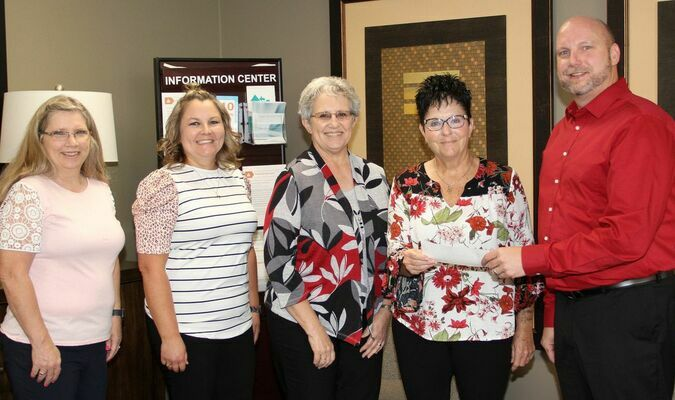 From left are Paula Glore, BSA/Cashier; Adrianne Logsden, Information Security Officer; Nancy Yount, C.F.O.; Jenny Allen, County Clerk and Brent Gant, Branch Manager.