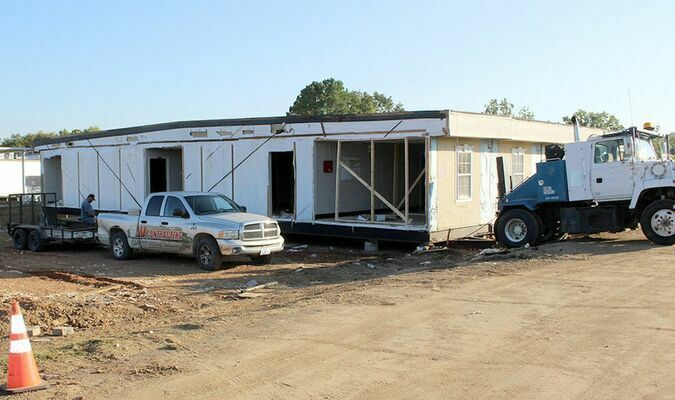 JV Contracting removing abandoned modular Elementary Building at K-14 School.