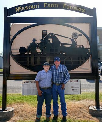 WASHINGTON COUNTY FARM FAMILY AT STATE FAIR – Gunnar and Brian Merkel stand in front of the new sign at the Missouri State Fair in Sedalia during this year's Bicentennial Fair Celebration in August. The Merkels said they had a good time and learned a lot. (Sub. Photo)