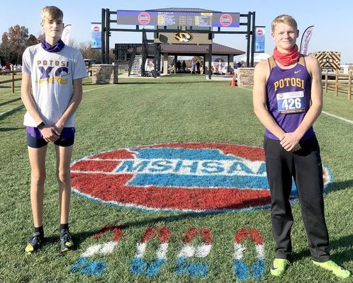 TROJANS AT STATE – Freshman Zeke Sisk, at left, and Senior Will Jarvis, at right, pose for a photo at the State Cross Country Meet on Thursday, Nov. 5th in Columbia.(Submitted Photo)