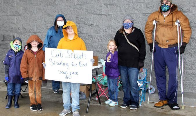 SCOUTING FOR FOOD 2020 – The local Boy Scouts began collecting food for food pantries with their 'Scouting For Food' program that began on Saturday, Nov. 14th. The Scouts are not going door to door this year due to the pandemic and health concerns. The Scouts took a different approach and set up 'Donation Stations' at Potosi Save-A-Lot and Walmart on Saturday. The weather was terrible and the Scouts tried to dodge the rain drops as they received food items from the public. They typically drop off bags on one Saturday and pick them up on the next. This coming Saturday, Nov. 21st, the Scouts will again be at the parking lots to collect from 10 a.m. to 12 noon before going to the pantries.