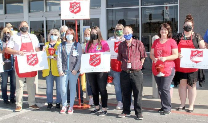 IT'S RED KETTLE TIME AGAIN! – A group of supporters and volunteers gathered at the Potosi Walmart to 'kickoff' The Salvation Army's bell ringing season locally. The group included, from left, County Clerk Jenny Allen, Carla Brand, Mayor Joe Blount, Valerie Dornbach, Kay Hackworth, Layne McClanahan, Michelle Adams, Walmart Manager Ashley Axtetter, Janey Radford, Eddie Strauser, Sandy Heeding, Kimberly Watson and Craig Somerville. The kettles will be in place and collections begin on Friday, Nov. 27th in Potosi by the bell ringers. The Salvation Army collects donations during the holiday season and provides support throughout the year locally in Washington County. At right; City of Potosi Mayor Joe Blount delivered a 'Resolution' to the Washington County Salvation Army Unit at the 'kickoff' recognizing the years and support The Salvation Army gives to the community year 'round. The majority of funds collected locally stays here to help with a variety of needs throughout the calendar year. Be sure to watch for the small red kettles on several retail counters around Washington County.
