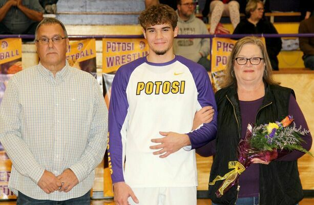 RYKER WALTON, #4 for the Trojan Basketball Team was recognized with his parents, Tim and Kim Walton. Ryker plays basketball and baseball for Potosi and will continue his baseball career at M.A.C.
