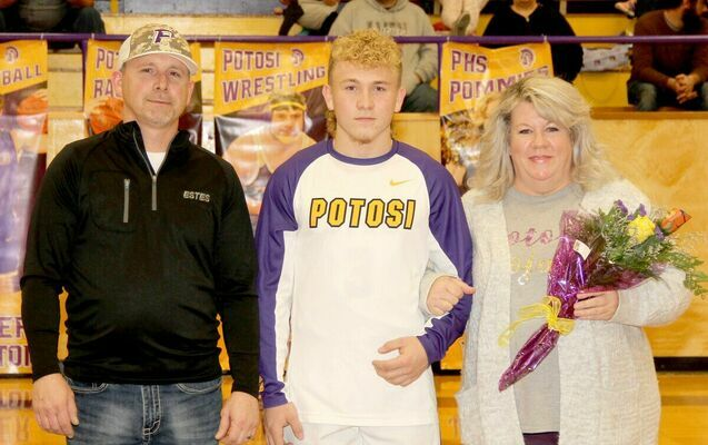 SENIOR BASKETBALL PLAYER Landon Bone was joined on the court by his mom and dad, Ryan and Stephanie Bone for Senior Night. Landon plans on attending M.A.C. and playing baseball.