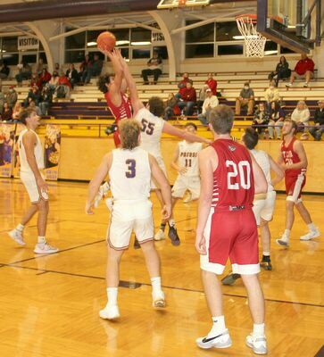 TROJAN DEFENSE - #55 Bryce Reed goes up to block a St. Clair defender during Friday, Dec. 11th's contest at P.H.S. as #4 Ryker Walton, #3 Landon Bone and #11 Malachi Peppers watch the ball.