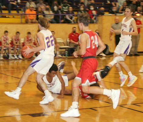 LOOSE BALL – #15 Jaden Kanan knocks the ball loose and #22 Ty Jarvis picks it up to head down court, #4 Malachi Sansegraw looks to help.