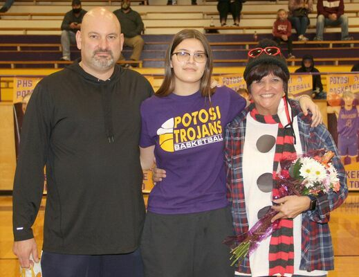 SENIOR LADY HONORED – Rain Hongsermeier-Baxter, #45 for the Lady Trojans was recognized with her mom, Shari Hongsemeier-Baxter and her dad, Kevin Baxter on Monday, Dec. 14th at the P.H.S. gym.