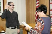 HAWORTH SWORN IN AS DEPUTY CORONER – On Wed., Dec. 30th, 2020, after swearing in the new County Coroner Steve Hatfield, County Clerk Jenny Allen swore in Ethan Haworth as Deputy Coroner for Washington County in the Commission Room at the Courthouse.