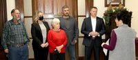 OATHS OF OFFICE & PAPERWORK TO START 2021 – Washington County Clerk Jenny Allen went over the Oath of Office with those being sworn in and discussed paperwork needed to start the new year in office. From left, Cody Brinley, Ashley Gum, Judy Gillam, Doug Short and Zach Jacobsen wait to be sworn in to their offices for Washington County. The official ceremony took place Thursday, Dec. 31st at the Courthouse.