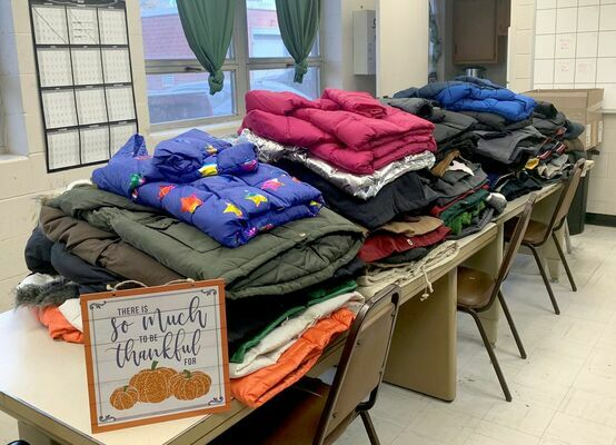 SPREADING HOLIDAY CHEER – Doe Run employees collected 90 coats for the mission in Bunker and provided holiday gifts for local families through the Bunker R-3 School District.	          (Submitted Photo)