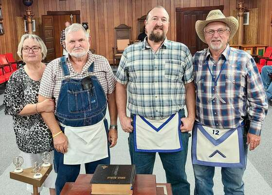 From left, Mrs. Gale (Beverly) Wells, R.W. Brother Gale Wells, R.W. Bro. Randy G. Wells and Tyro Lodge Worshipful Master Joseph Tiefenuer. Brother Gale and Randy joined Tyro after the closure of the Belgrade Lodge.