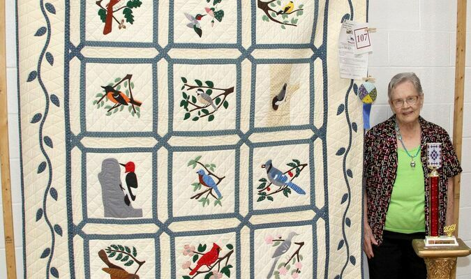 The winner of the 2021 Caledonia Quilt Show 'Best of Show' was Mayno Woods with her beautiful 'Birds' quilt. The Quilt Show was held on Saturday, June 12th, 2021 at the Valley High School gymnasium. The show attracted a large crowd during the day and had a large number of quilts that featured several styles, colors, and patterns. The 'Best of Show' was voted on by the public that attended. Mayno said she still loves to quilt and the quilt here was done in 1990. The Quilt Show also featured the 2021 Missouri Bicentennial Quilt, on loan from the State of Missouri.