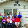 Cheryl Elliot, Ewing Mayor Dean Wagy and City Clerk Cheryl Thrower (seated middle) and engineer Mark Bross, along with members of USDA Rural Development and other officials at the announcement of a Water and Waste Loan for the City of Ewing. Also pictured are (back standing)  D.J. Lewis and Simon Thrower.