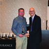 Cameron Insurance Companies President Brad Fowler, right, presents the President's Award plaque to Brad Sharpe.