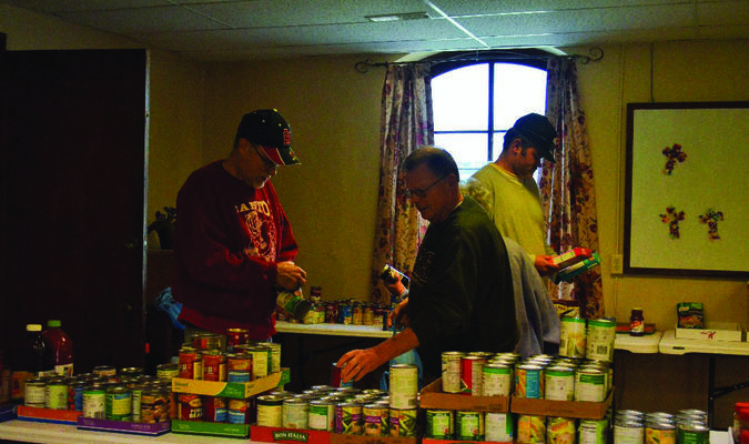 Cliff Hark, Jerry Prather and Chris Holt at the Canton Council of Churches food pantry. Generous donations of the community were much appreciated.