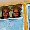 Jessie Cary and Karyann Cox on their last school bus ride. Seniors went to the Elementary School in cap and gown and walked through the halls amid cheers and congratulations from the young students.