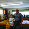 """Jason Vaughn, Conservation Officer, concluded the July programing by providing a fun and informative day for the LaBelle and  Libraries.  The children utilized the great outdoors for a """"fishing competition"""". Draven Johnson caught the most fish and Draven also won the backpack of goodies and  book in the door prize drawing."""
