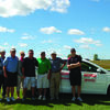 Tracy Job of Shottenkirk and other players with a new Toyota Camry at hole nine. Players had a chance to win the car by making a hole in one on the ninth green at the Kiwanis Golf Tournament held September