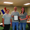 Canton Mayor Jarrod Phillips presents a proclamation to Aron Knocke and Crystal Bell of A and C Paint Studio.