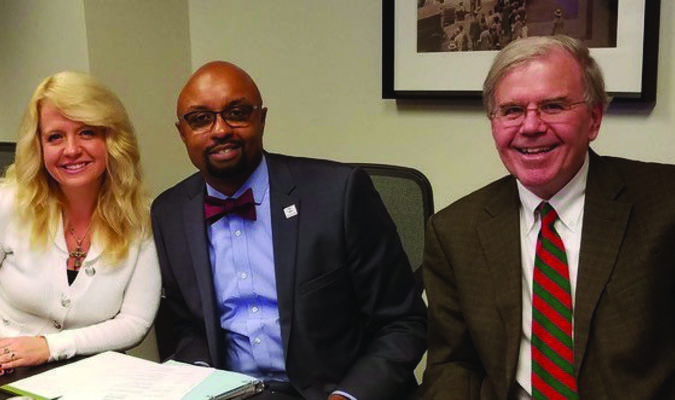 Pictured are (l-r) Michele Jochner, Vice Chair of MCLE Board, Vincent Cornelius President of IL State Bar Assoc and Attorney Jim Rapp.
