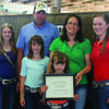 Ronnie and Angie Hamlin and daughters Macy and Isabella were selected at the Lewis County Missouri State Fair farm family, Also pictured with the Hamlins is Brenda Arnold, Lewis County Extension Program Director and Livestock Educator.