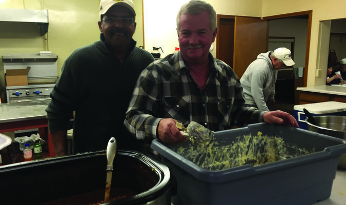 The next Lions Club fish fry in LaGrange will be held March 18 with serving from 4:30 to 7 p.m. The event is very popular  and a large crowd usually attends. Pictured at the fish fry held March 3 are Lions Club members  Jimmy Dade and PJ Logsdon