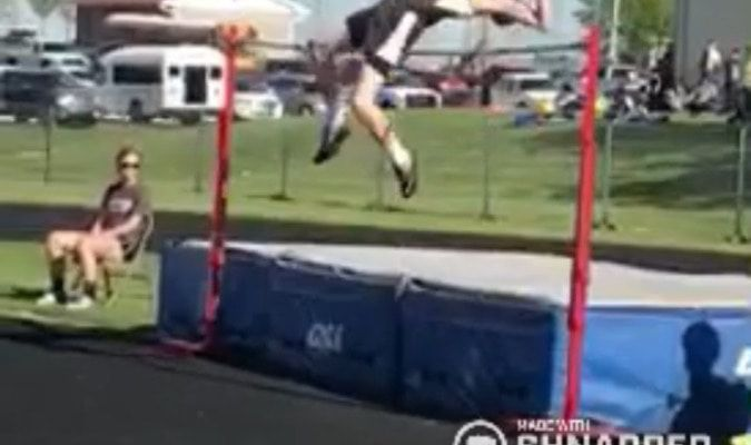 Tommy Job during his personal best record of six feet two inches in the high jump. Headline: Job ranked Top in Nation