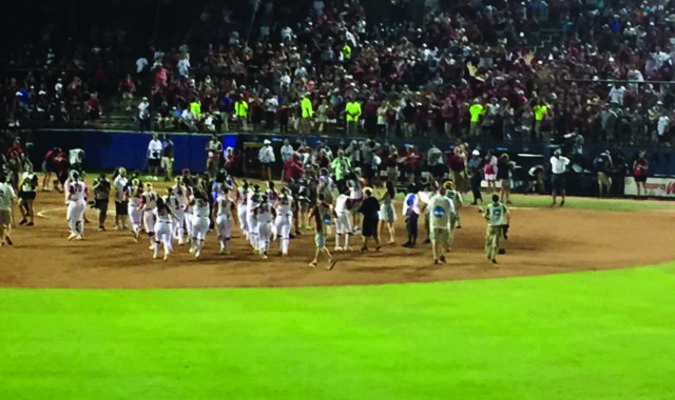 The Oklahoma Sooners softball team on the field after winning the National Championship.