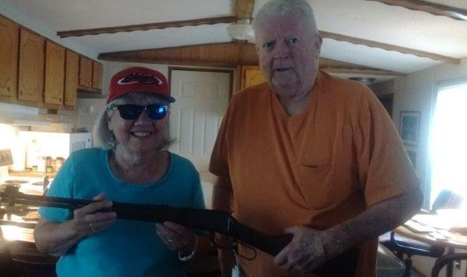 Donna Johns LaGrange Nutrition Center Manager presenting the Henry 22 rifle to Joe Kennedy of LaGrange. Joe had the winning ticket from Heartland Resources Inc. Gun Raffle.