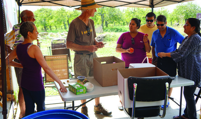 Dan Kelly, center, talks with customers from St. Louis and Quincy who attended the Blue Heron open house on Sep. 24.