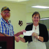 Robert Deters, president of Lewis County Farm Bureau, presented Lezlie Durst, Agricultural instructor at Canton High School, a check from Missouri Farm Bureau's mini grant to improve the school's green house project.