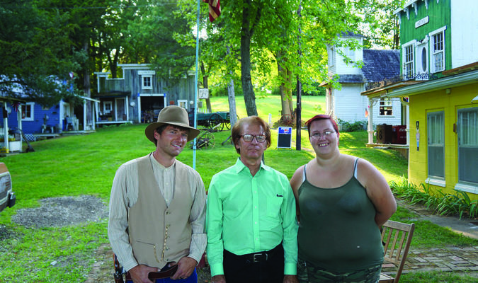 Robert Wyatt (center) with former student Jessica Shepard (right) and his son Daniel (left), who also graduated from the school