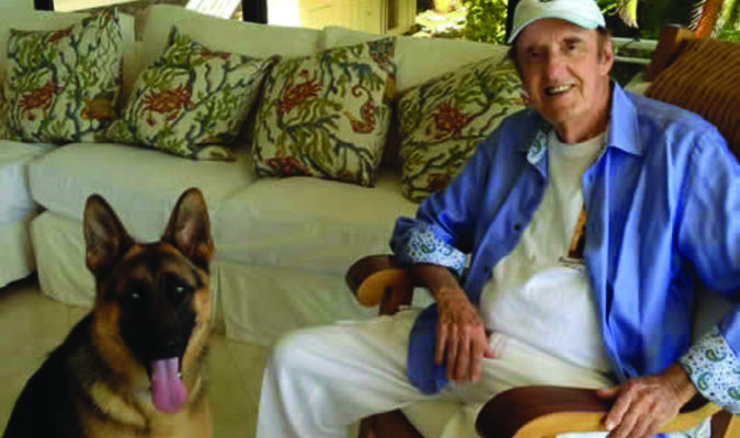 Jim Nabors, famous for his character Gomer Pyle, with his dog Jimbo at their home in Hawaii.