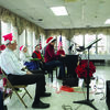 Kevin Wang played piano at the Lewis County Nursing Home on Dec. 14 as a guest of the Senior Stars Band.