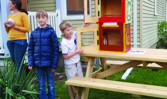 Indigo Oak in Canton unveiled a Little Free Library book exchange at their location. Residents are encouraged to leave books in the box and feel free to take to take a book to enjoy. The lower compartment is for children's books. Also pictured is local artist Terry Hawkins.