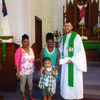 Jacob Hercamp of St. Peter's Lutheran Church of LaGrange, presents a check to the Chamar Mayes family, from a fundraiser the church held to help with expenses. Charmar is undergoing treatment for a brain tumor. Also pictured is Chamar and his mother Chante and grandmother Greta Lewis.