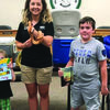 A total of 45 children and adults attended the Summer Reading Program at the LaGrange Library.   Mallory Machir from Blank Park Zoo is pictured with Owen Harlan and Austin Weaver, winners of the book give away on July 25.