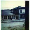 Pictured is the Ridge Garage on Main Street in LaGrange in 1973 after flood waters damaged the building and the Solter's Superette building. The buildings collapsed, therefore ending an era. A new hardware store was built in the grocery store lot and was owned by John Solter, then was occupied by the Town and Country Bank for years, until last fall when a new facility was built on the west side of Main Street.