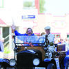 Culver-Stockton College President Mary Thompson waves to the crowd of parade views as she is driven down the Canton streets in an antique automobile owned and driven by Bill Dorris.
