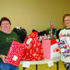 Judy Eaton and Stephanie Stein at the Adopt a Family Christmas give away in 2017.
