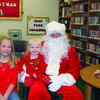 Addie and Mabrie Lay tell Santa what they would like for Christmas.