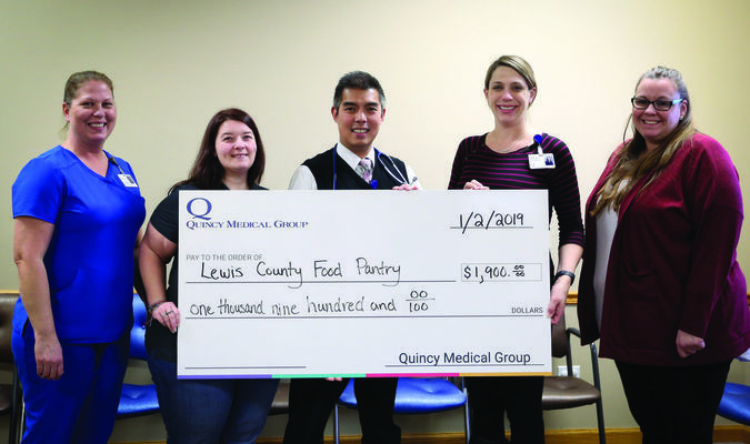 The Lewis County Food Pantry received a donation from the Quincy Medical Group and QMG  Healthcare foundation. Pictured are (l-r): Eva Bracey (Quincy Medical Group), Pastor Mandy Gosik (Lewis County Food Pantry), Dr. Arvin Abueg (Quincy Medical Group), Sara Reuschel (QMG Healthcare Foundation), and Danielle Casey (Quincy Medical Group).