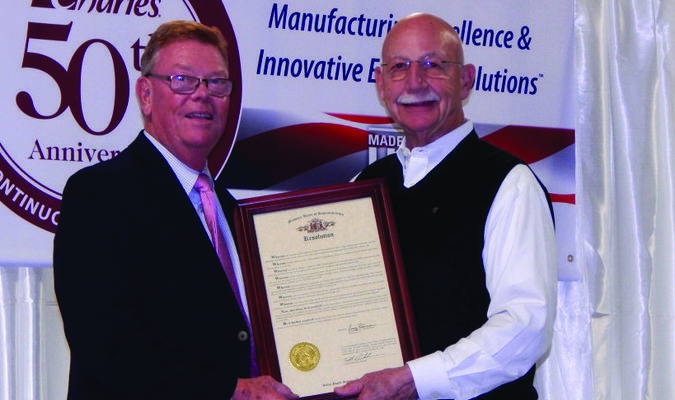 State Representative Craig Redmon presented a resolution to Joe Charles commemorating 50 years of service.