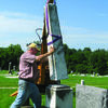 Jacob's Ladder repairing an older grave marker.
